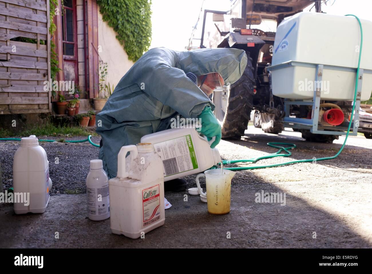 Farmer Mixing Novartis� Chemicals (callisto, Milagro) To Spray On Corn  Fields,