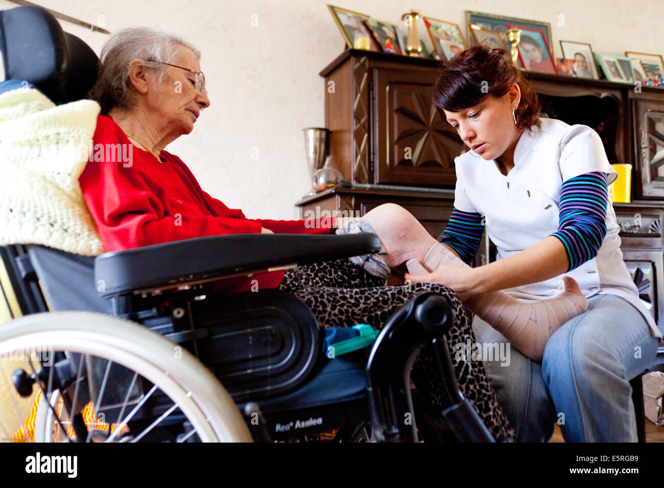physiotherapy session at the home of an elderly woman with a stock