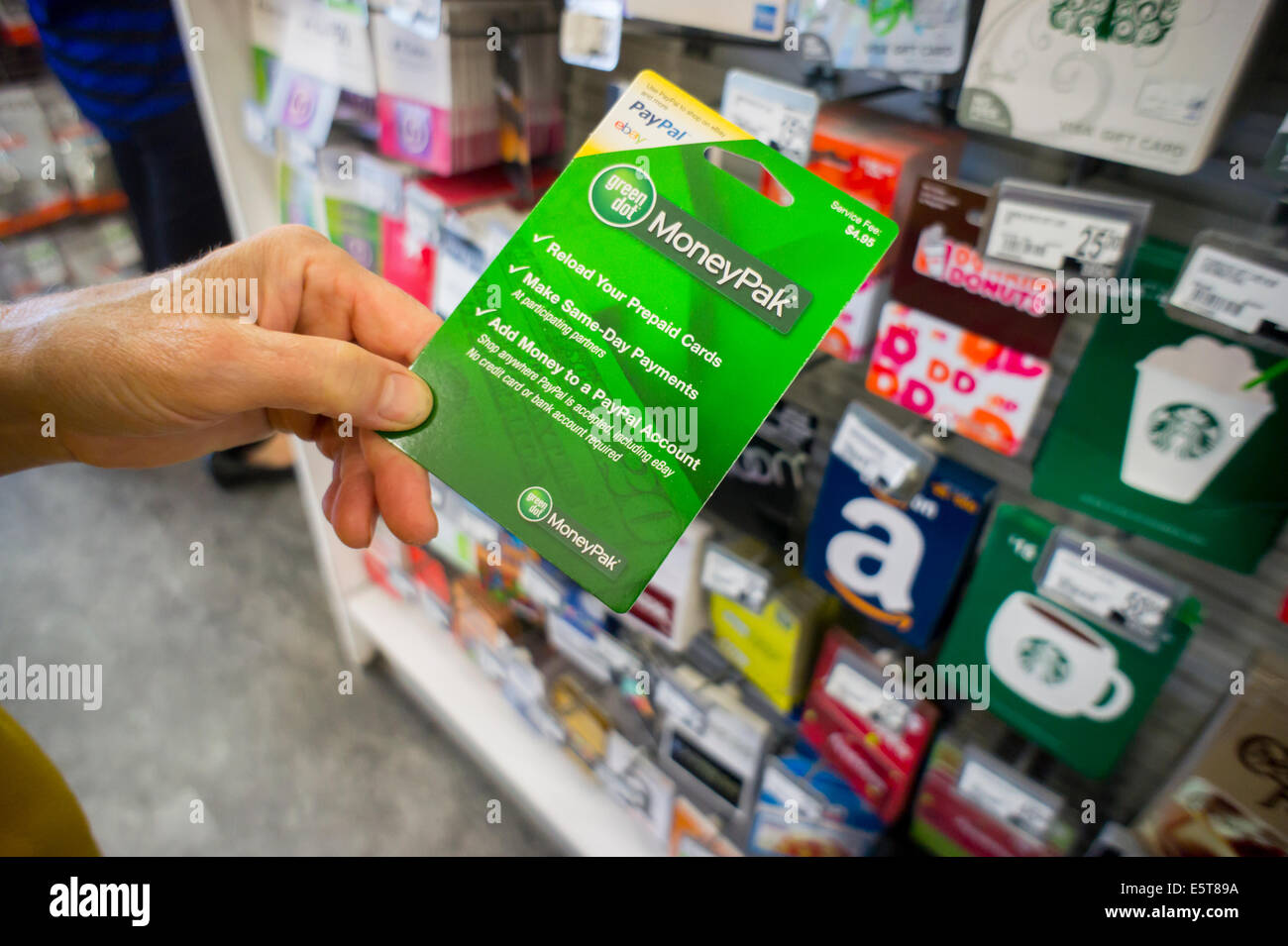 a shopper chooses a green dot brand moneypak prepaid card in a a shopper chooses a green dot brand moneypak prepaid card in a store in new york