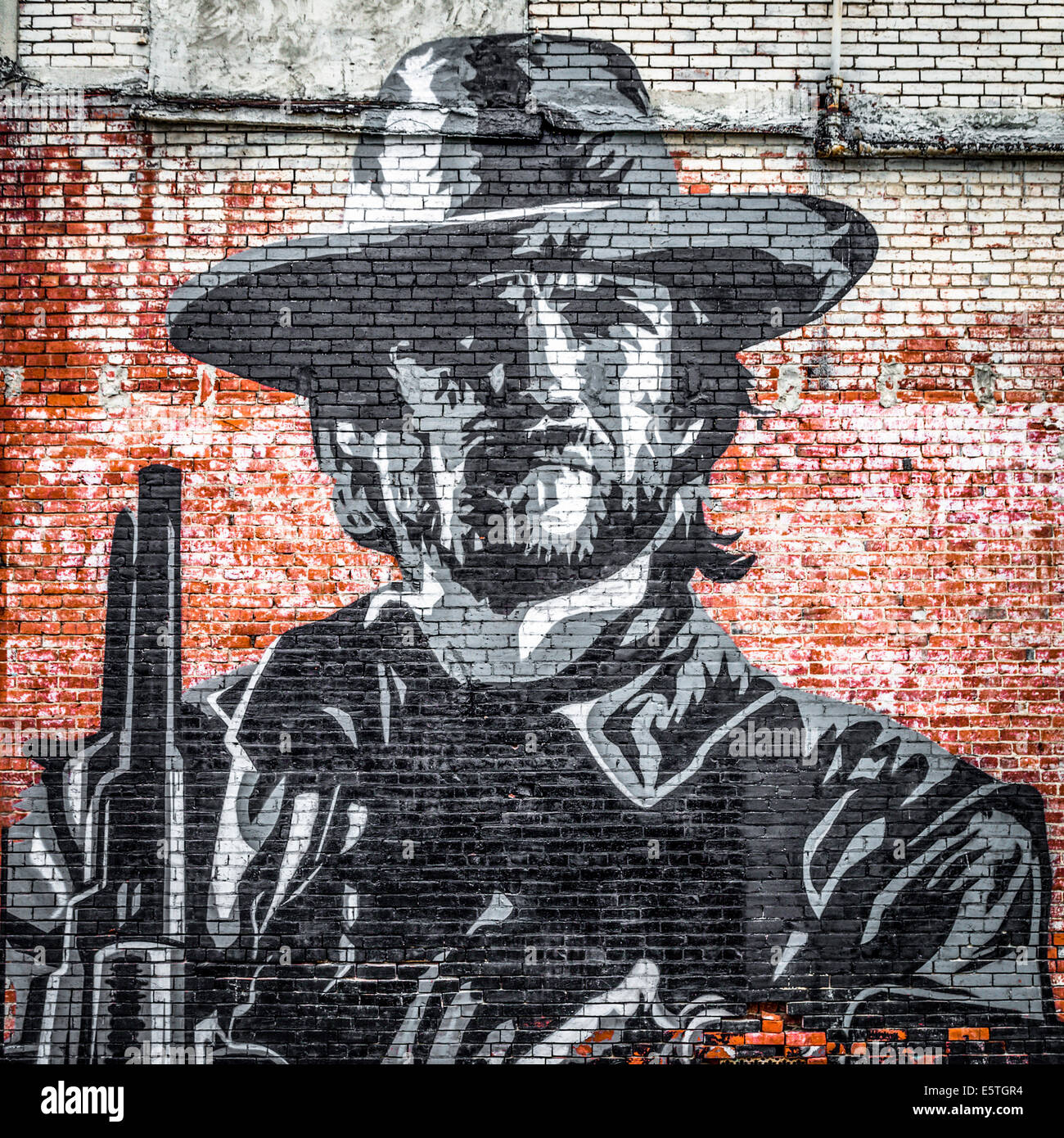 Street art mural of a cowboy on a brick wall clarksdale for Cowboy wall mural