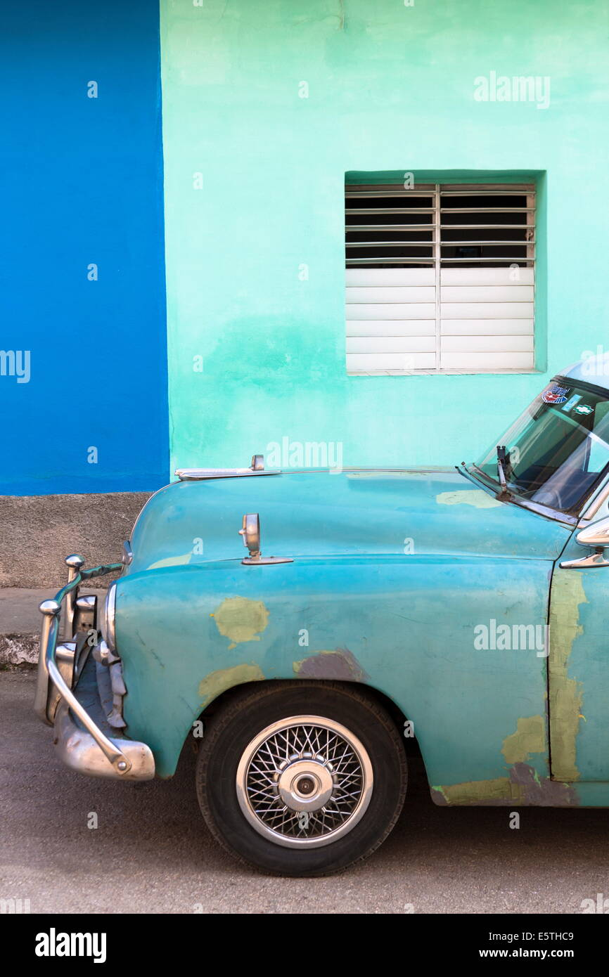 Vintage American car in front of the green and blue walls of a Stock ...