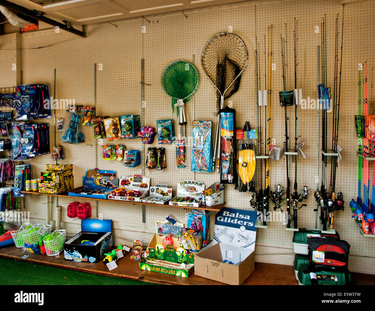 Fishing equipment for sale at an outdoor market stock for Fishing supply stores
