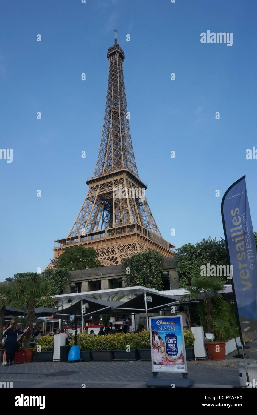 Outdoor cafe in paris with tower in background - Paris Cafe Terrace With Eiffel Tower In The Background And Posters In The Foreground Stock