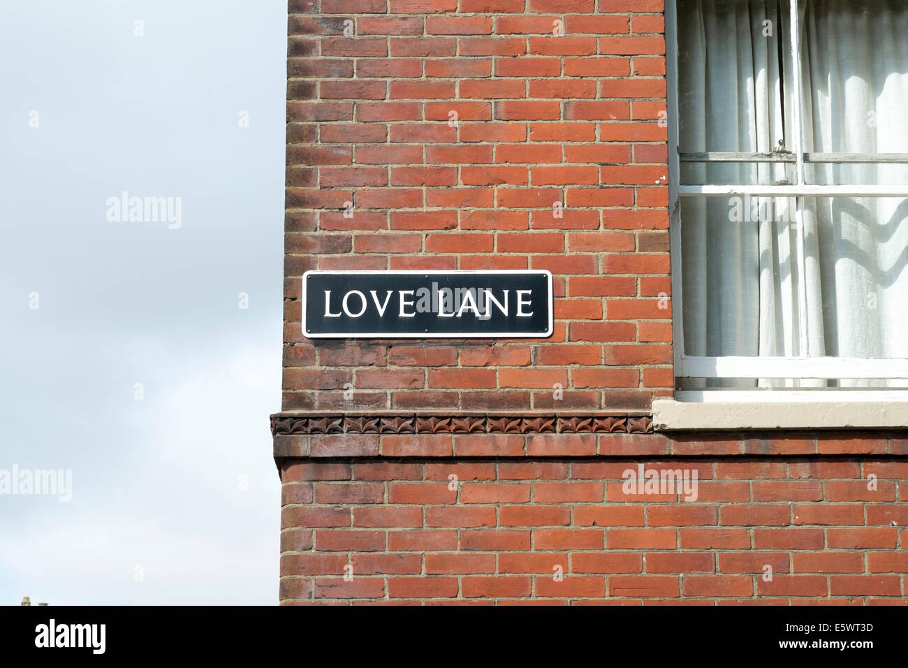 Love Lane Street Name Sign On Side Of Red Brick Building UK
