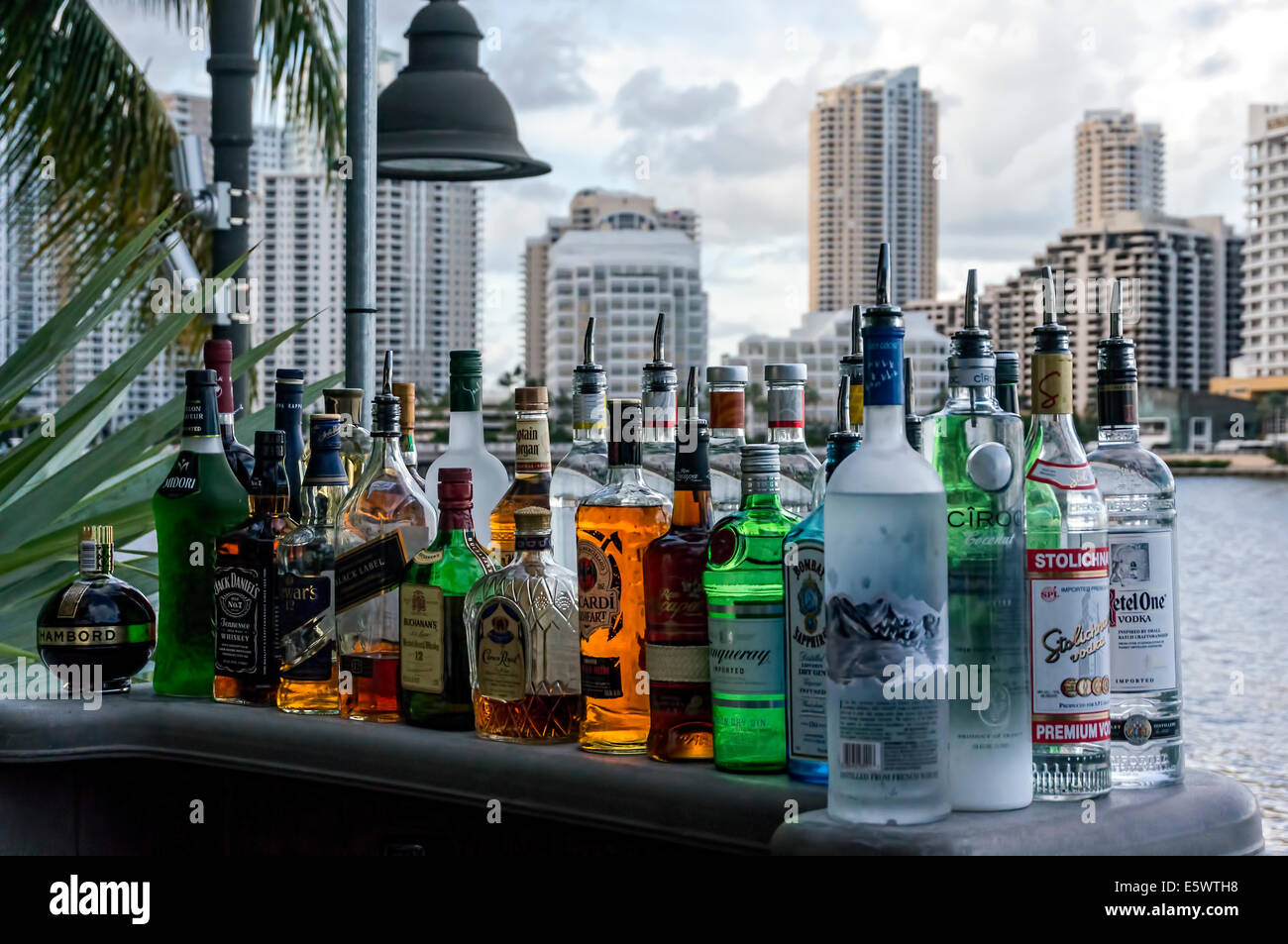 Liquor Bottles Sit On The Patio Bar Of Crazy About You Restaurant On  Biscayne Bay In Brickell Area Of Miami, Florida.