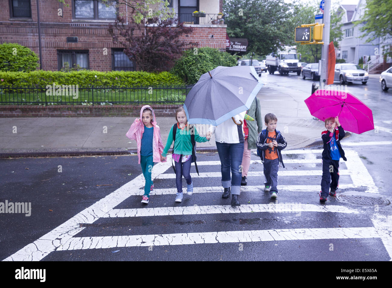 Children go home after school on a rainy day in brooklyn for Buying a house in brooklyn