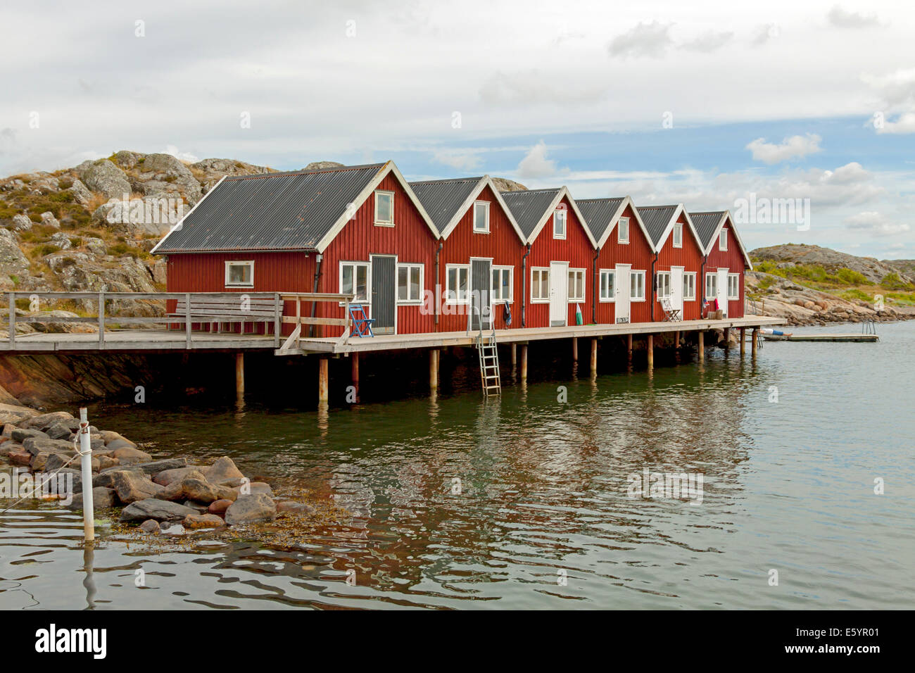 Typically Scandinavian architecture: Red wooden cottages at ...