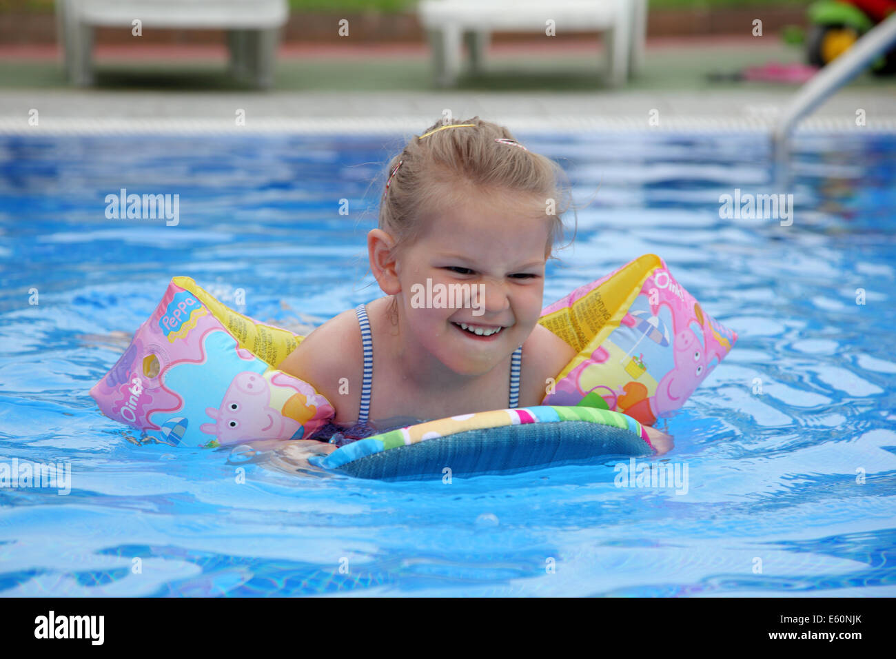 peppa pig stock photos peppa pig stock images alamy little girl swimming board and water wings in pool stock image