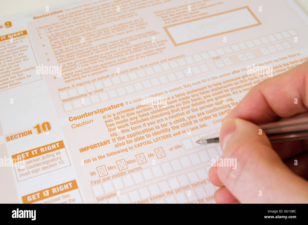 United kingdom passport application form stock photos united completing a united kingdom passport application form stock image falaconquin