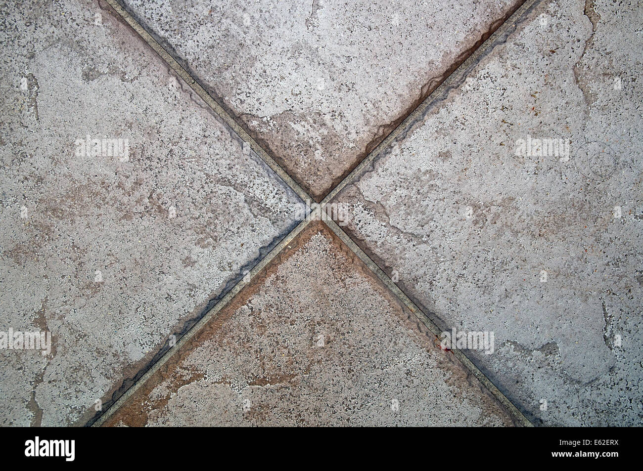 Large stone floor tiles joining together forming the letter x large stone floor tiles joining together forming the letter x dailygadgetfo Image collections