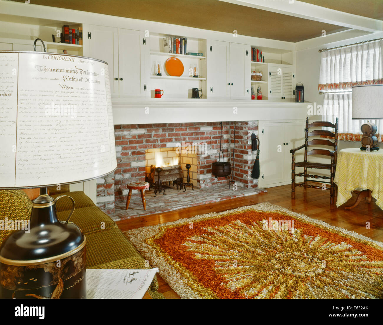 1960s INTERIOR OF LIVING ROOM WITH SHAG AREA RUG FIREPLACE AND EARLY  AMERICAN HOME DECOR AND FURNITURE