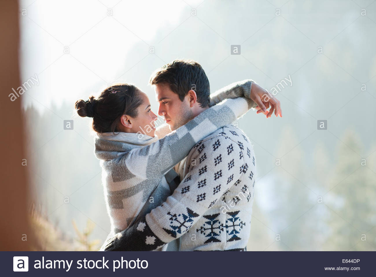 Couple hugging face to face outdoors. Couple Hugging Face To Face Outdoors Stock Photo  Royalty Free