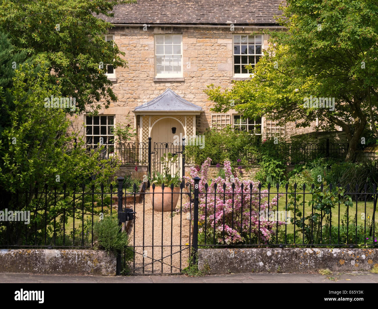 Most beautiful front garden uk stock photos most beautiful front old attractive stone town house cottage with pretty porch garden metal railings bath baanklon Choice Image