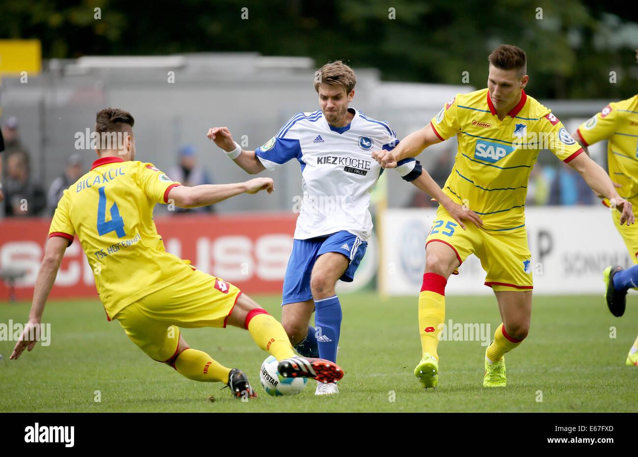 Hoffenheimu0027s Ermin Bicakcic And Niklas Suele (R) Vie For The Ball With  Paloma Hamburgu0027s