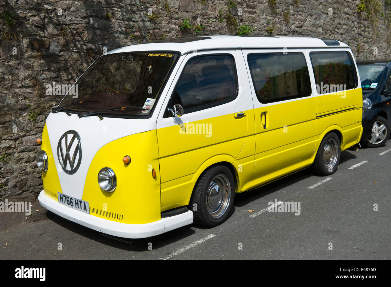 Yellow White VW Camper Van Parked On The Street Brecon Powys Wales UK