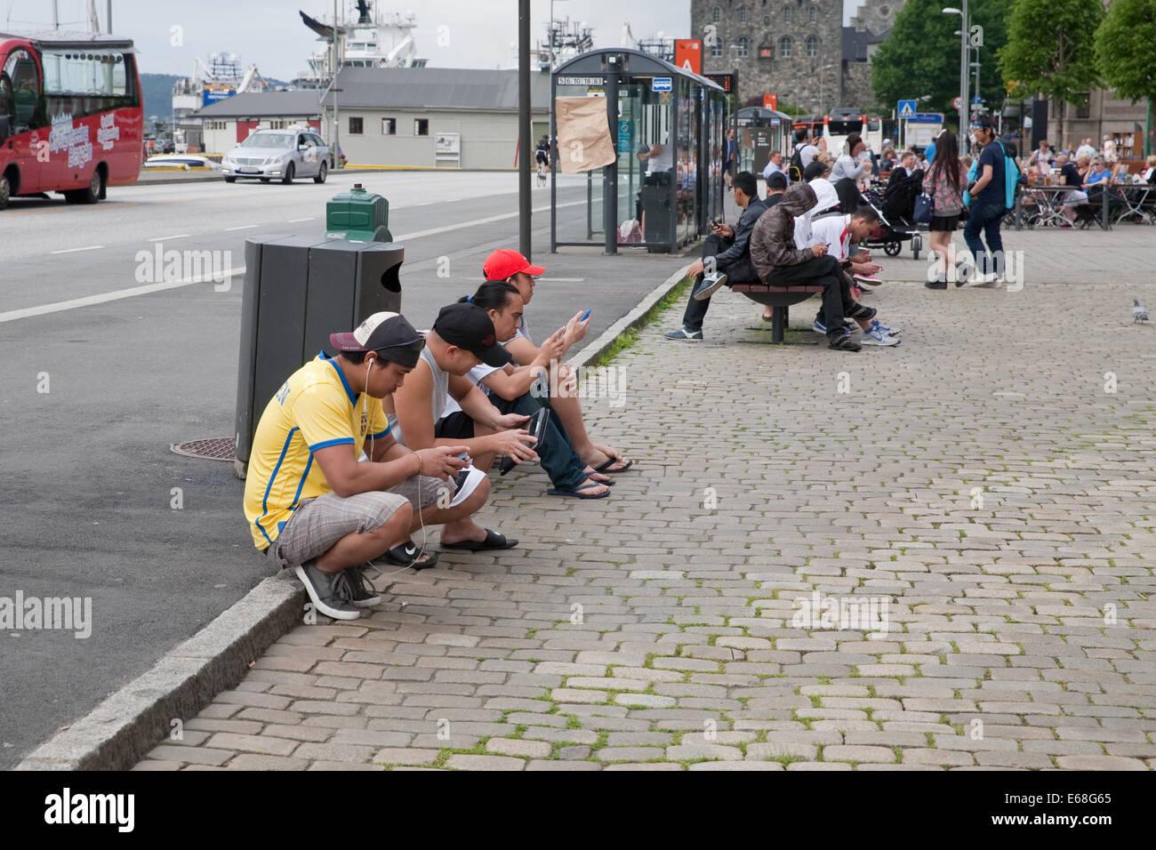 Cruise Ship Staff Use The Free Wifi In A Street In Bergen Norway - Cruise ship wifi