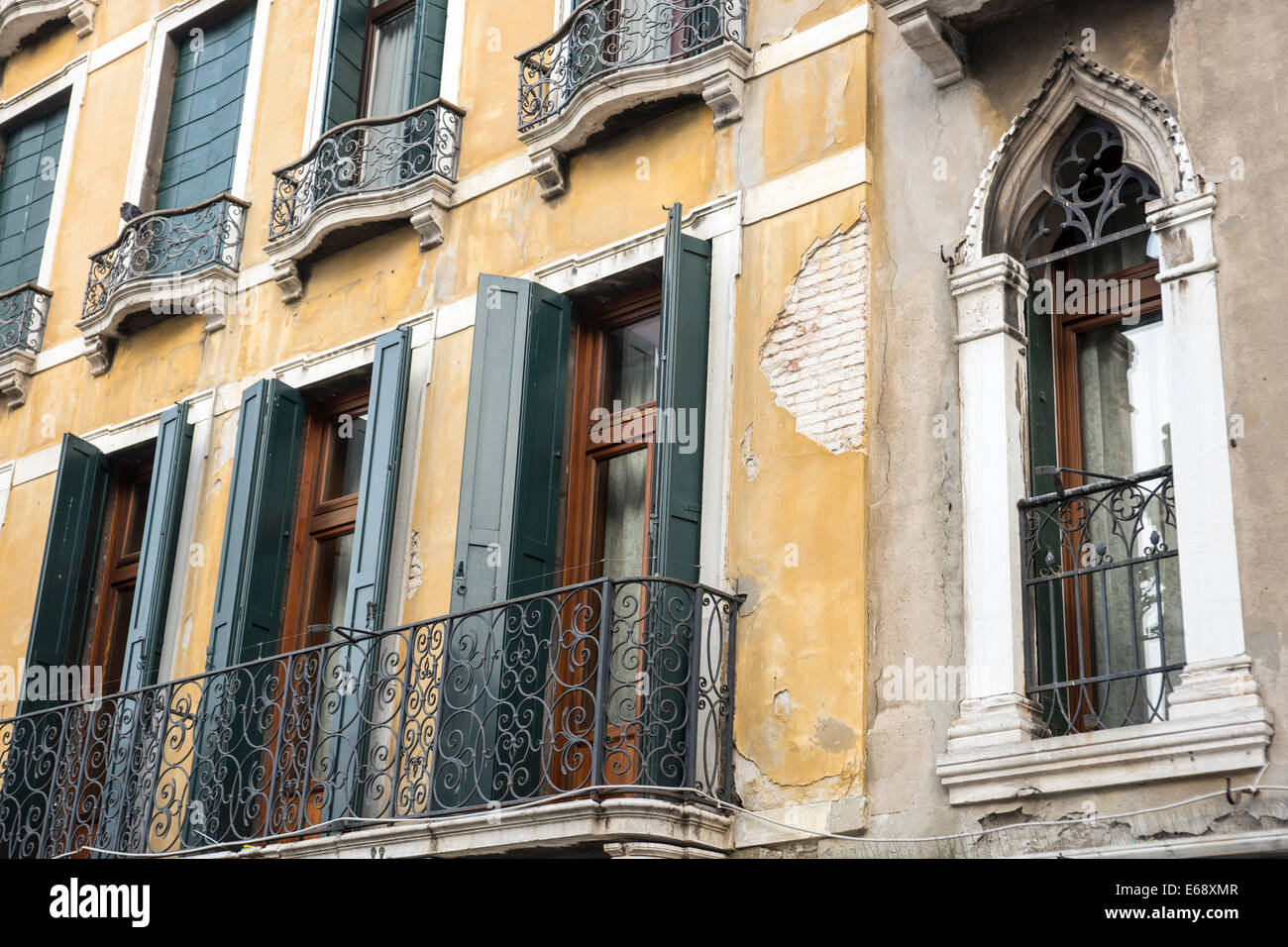 Detail of upper floor of old house with balcony french doors detail of upper floor of old house with balcony french doors green shutters and pealing plaster rubansaba