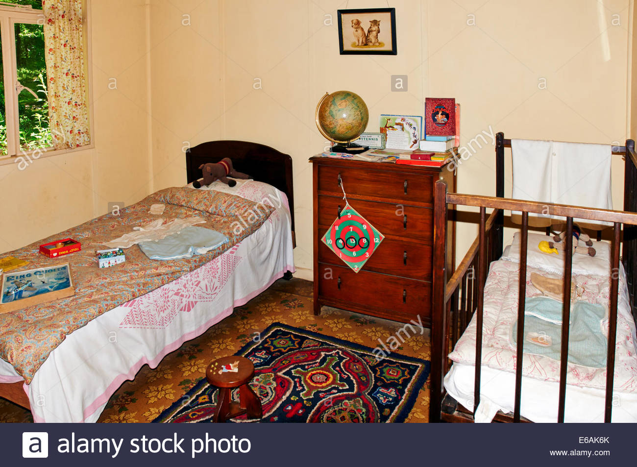 A 1950s Style Childrens Bedroom With A Single Bed And A