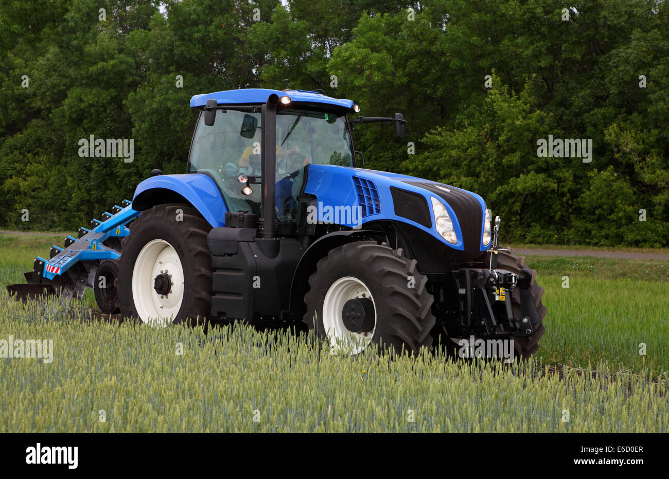 Blue Holland Tractors : Blue farm powerful tractor new holland td stock photo