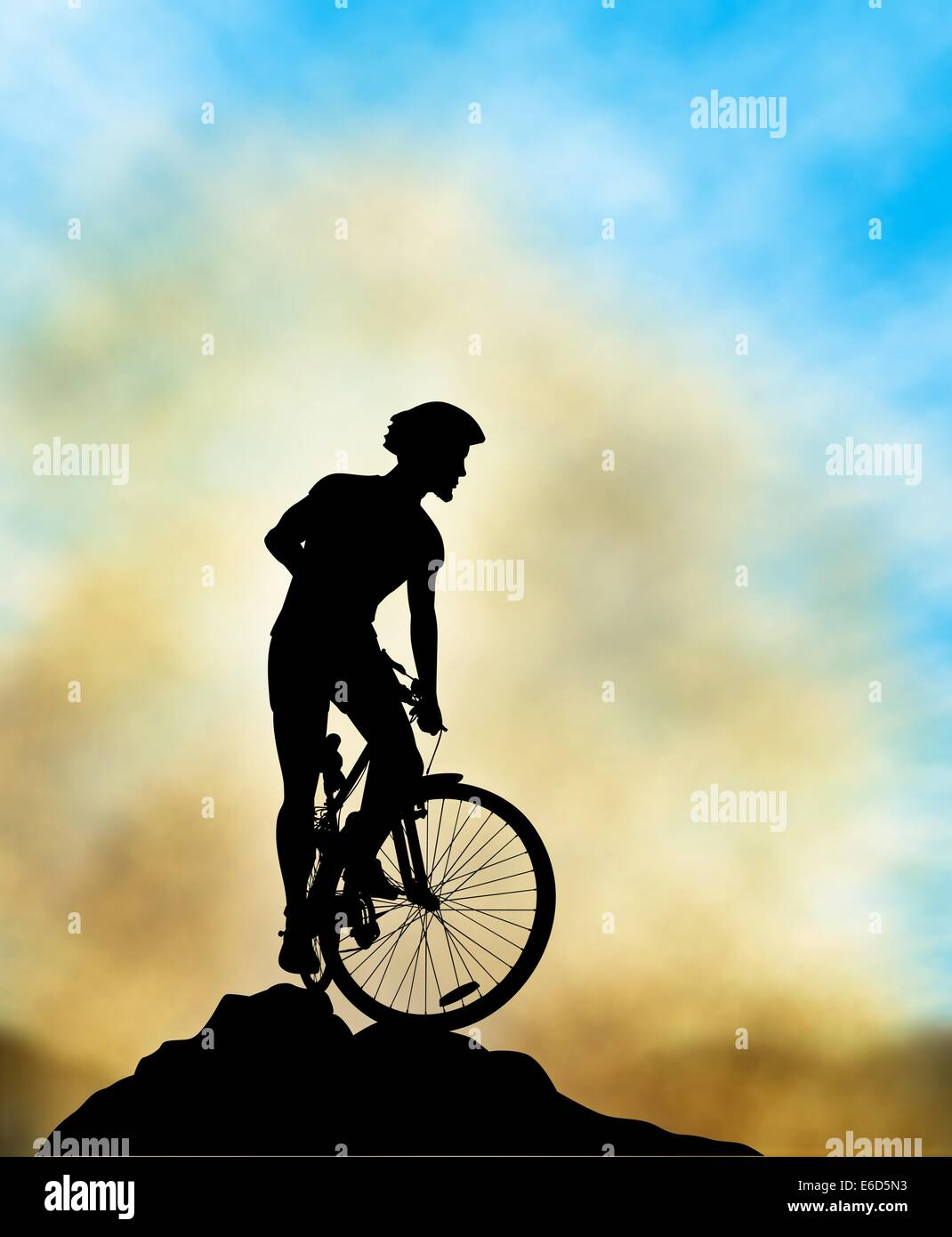 editable vector illustration of a mountain biker silhouette high on a ridge with background sky and mist made using a gradient m