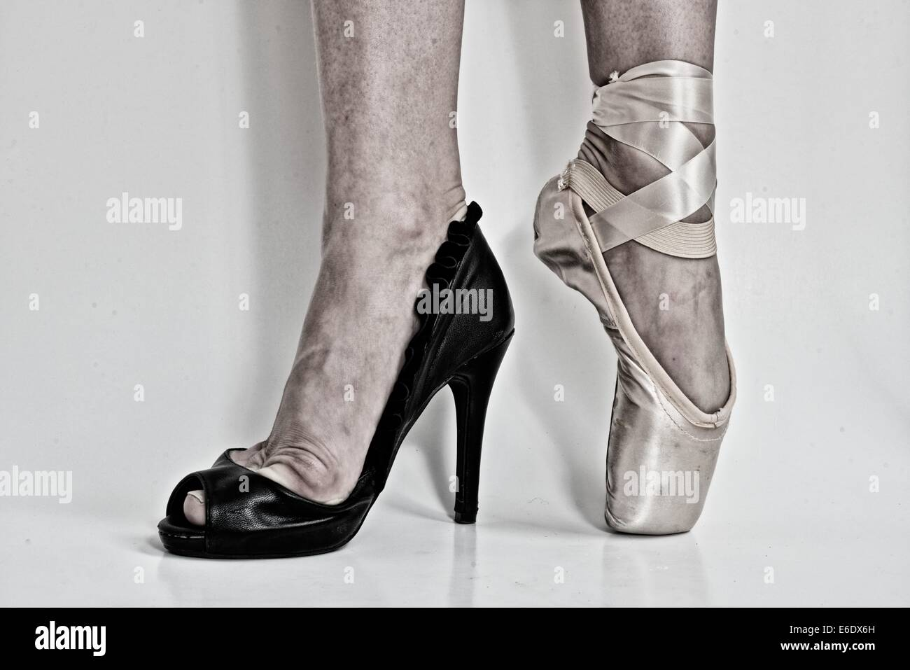 Legs Of A Ballerina With A Black High Heel Shoe In One Feet And A