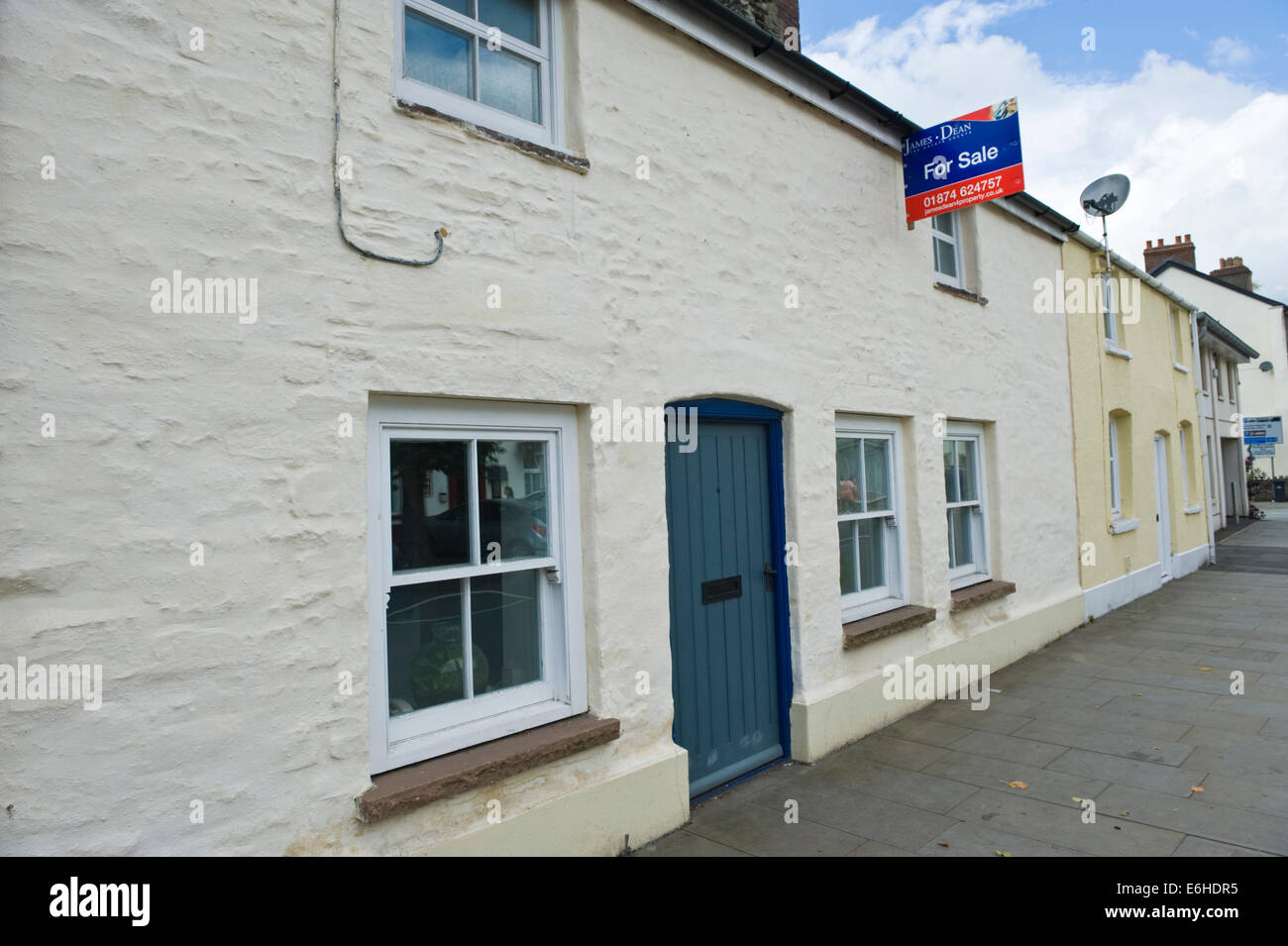 Wooden front doors of period terraced houses with sliding sash wooden front doors of period terraced houses with sliding sash windows in brecon powys wales uk rubansaba