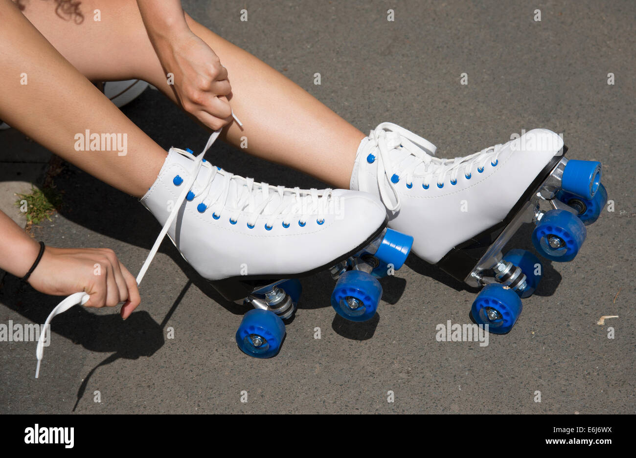Roller skates winnipeg - Fastening Roller Skates Tying The White Laces Up Of A Pair Of Quad Skates Stock