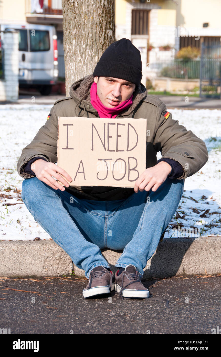 homeless young man looking for a job stock photo royalty