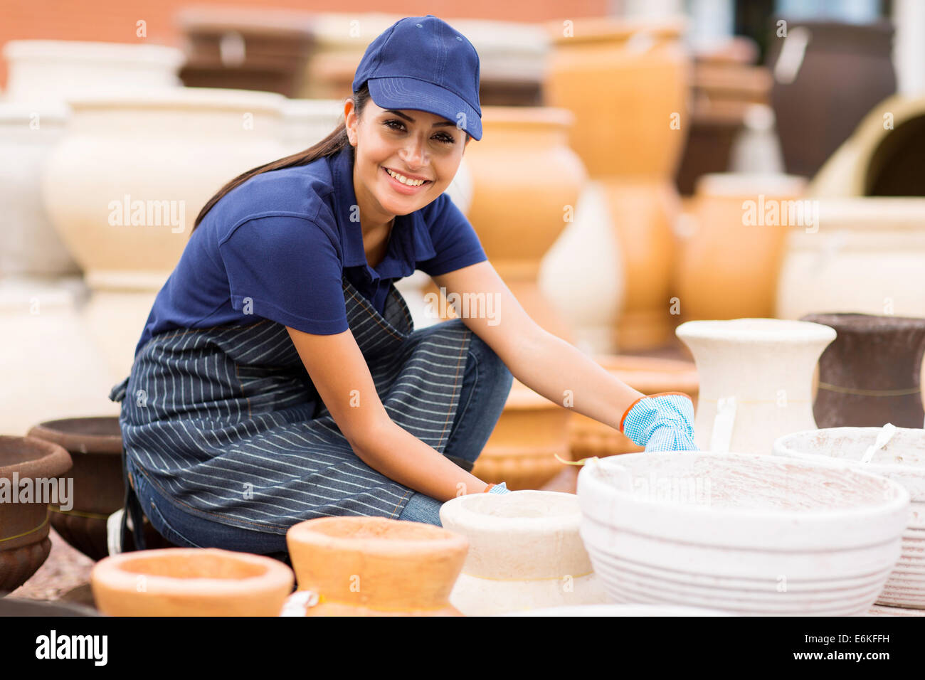 beautiful young hardware store worker stock taking stock photo pretty young hardware store worker working in home and garden center stock photo