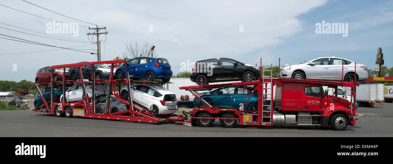 Car carrier trailer carrying nissan versa cars at pilot