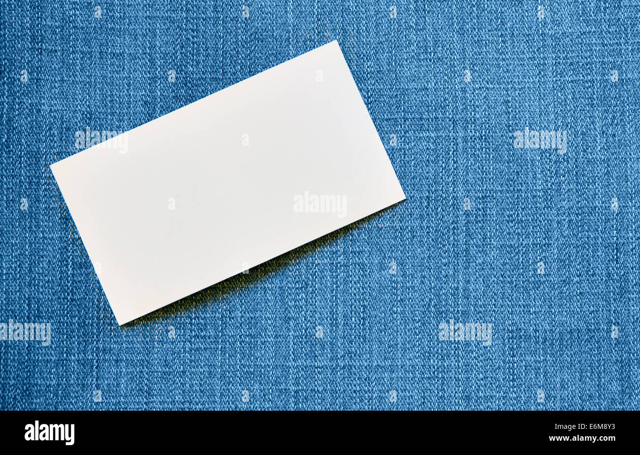 Blank visiting card over blue jeans background Stock Photo ...