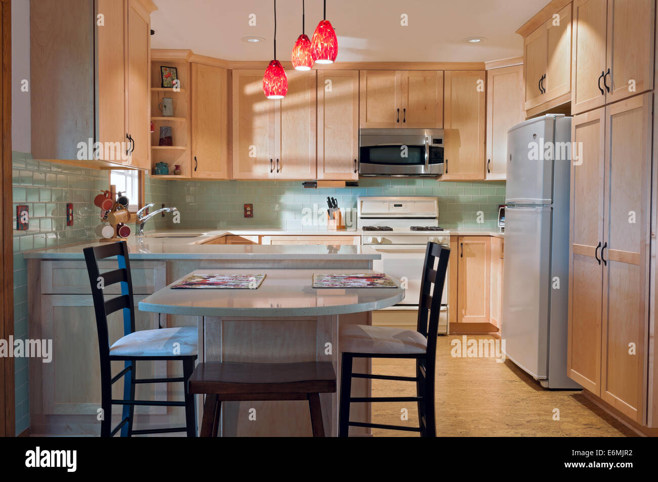 newly remodeled kitchen interior with cork floors maple cabinets and glass tile backsplash - Newly Remodeled Kitchens