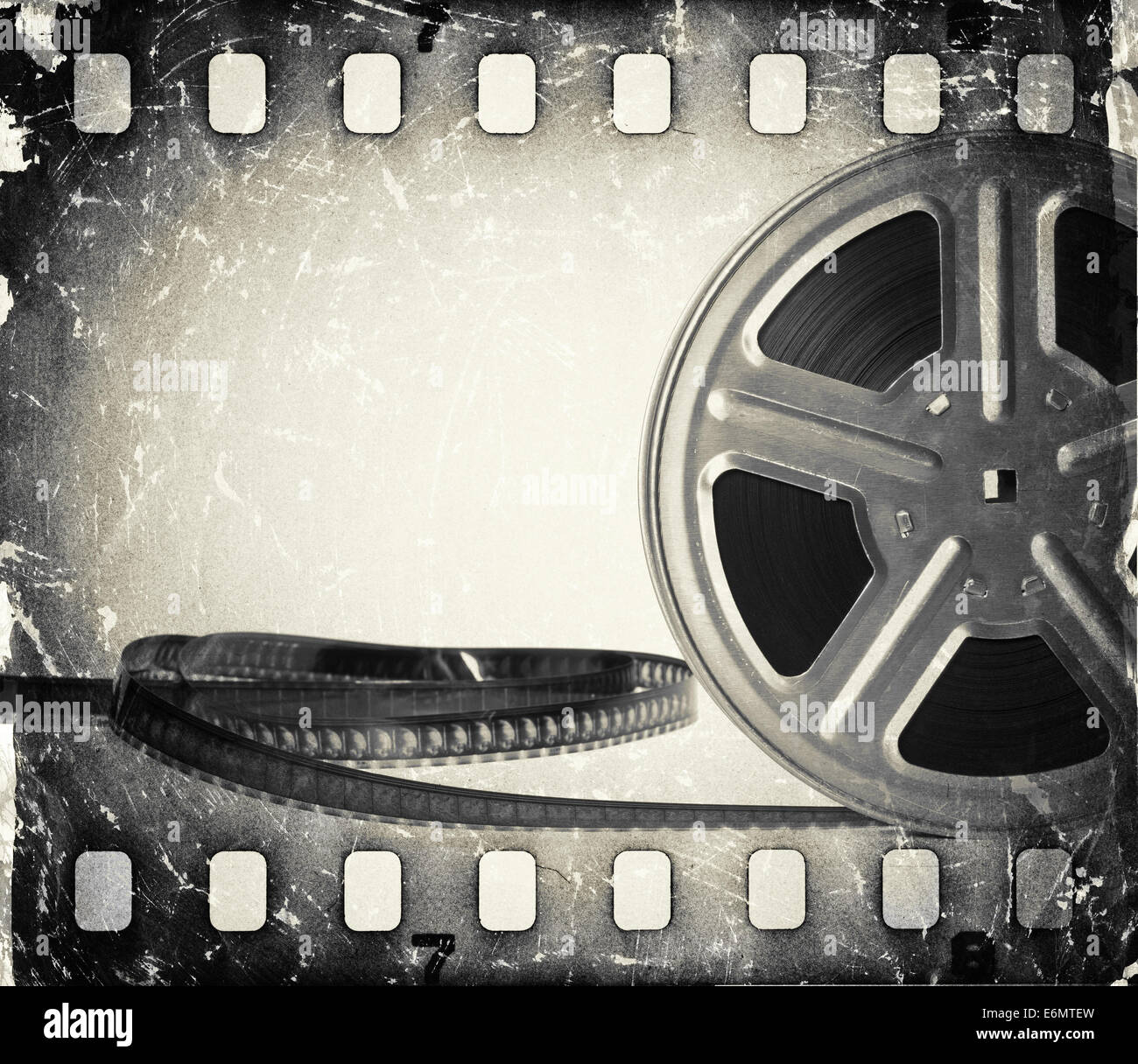grunge old motion picture film reel with film strip