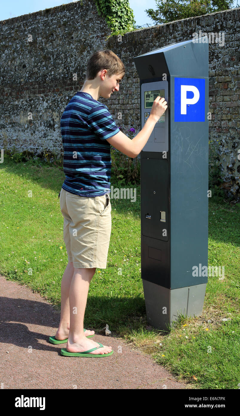 15 Year Boys Bedroom: 15 Year Old Boy Paying Parking Meter In Rue Des Corderies