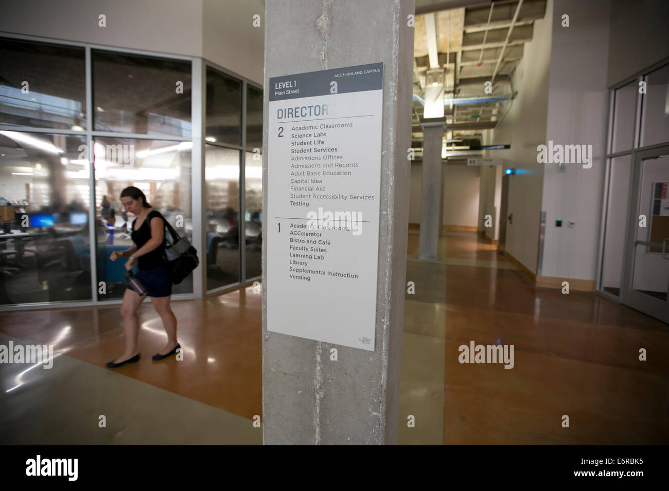 Students Relaxing Walking In Hallways Of New Campus Austin