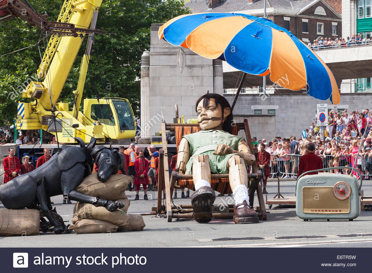 little girl giant and xolo the puppet dog sleeping outside queensway tunnel: metre giant umbrella