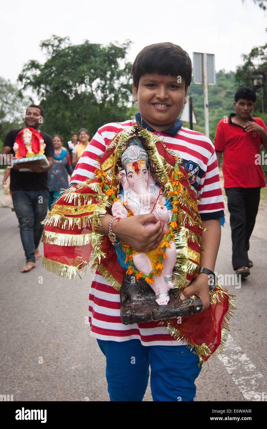 jaipur india 31st aug 2014 a boy carries the statue of stock