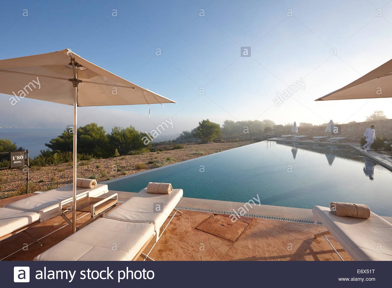 infinity pool and sun loungers hotel cap rocat ctra d 39 enderrocat stock photo royalty free. Black Bedroom Furniture Sets. Home Design Ideas