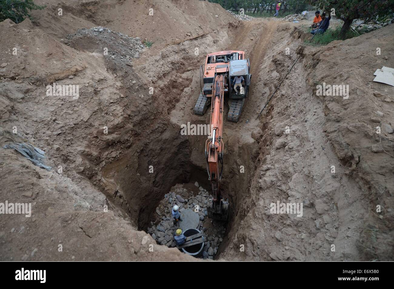 Huludao China  City new picture : Huludao, China. 1st Sept, 2014. An Excavator Tries To Dig A Well For ...