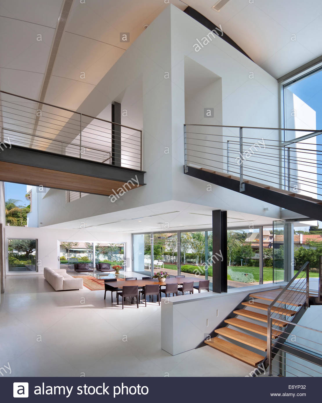 Access staircase in double height living room in luxury for Double height living room designs