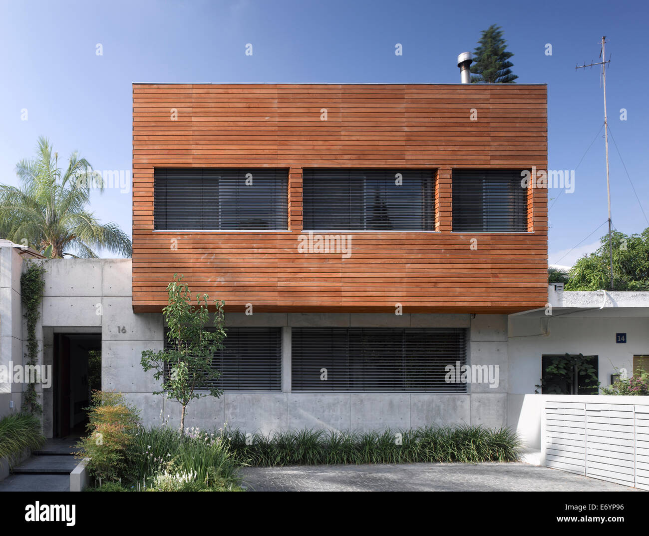 Wood and stone facade of s house israel middle east for Stone facade house