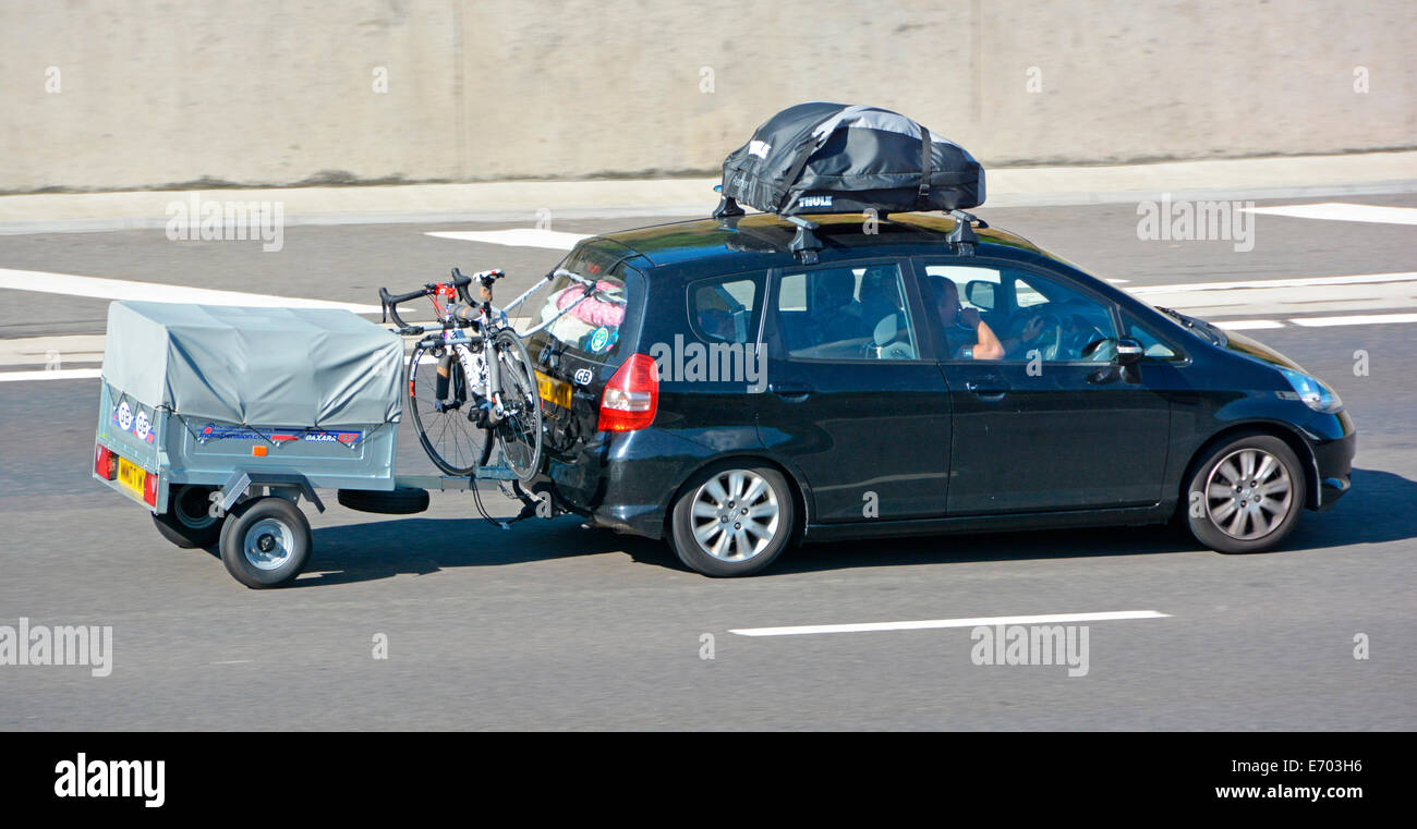 Hatchback Car With Roof Rack Cycle Rack And Towing Trailer (obscured Number  Plate)