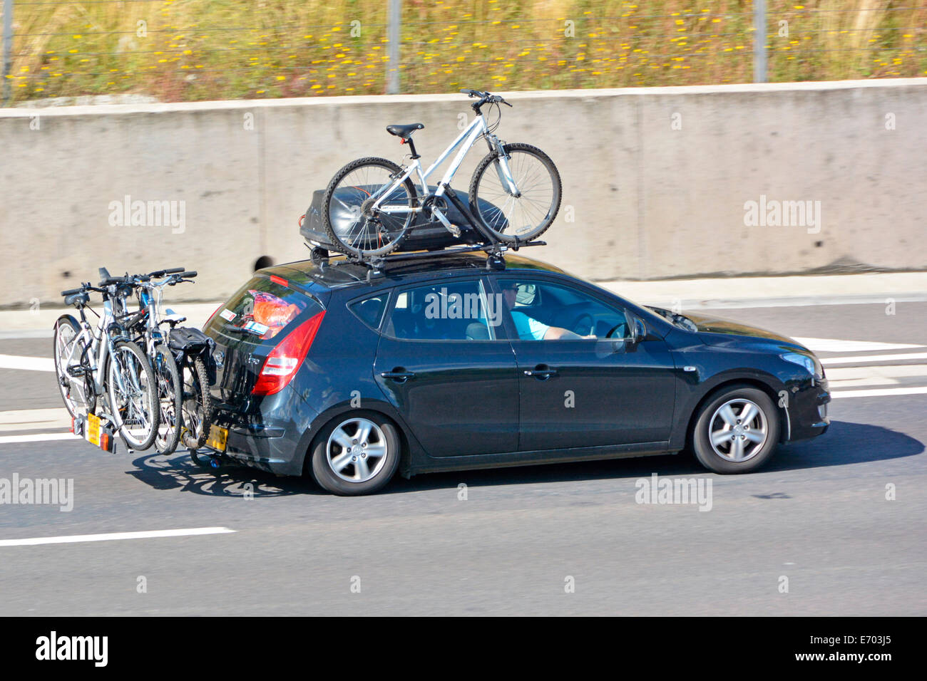 Car Driving Along Motorway With Roof Rack U0026 Top Box Fitted With Bike Also  With Rear