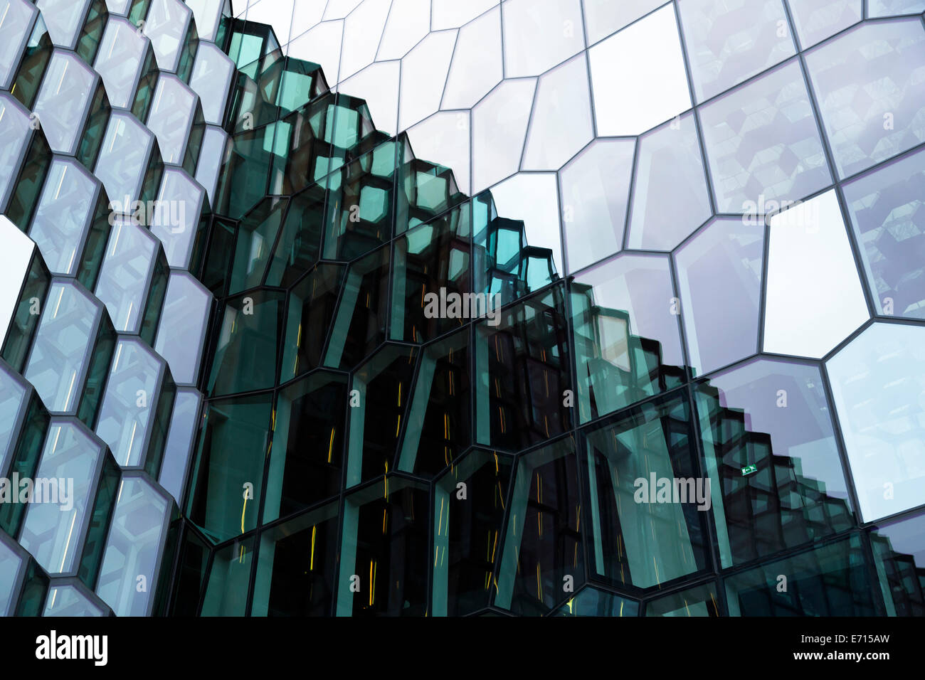 Island reykjavik reflection on glass facade of harpa for Refection facade