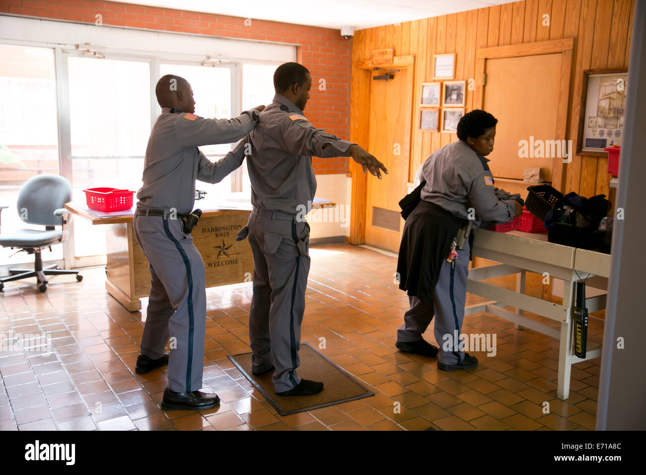 Security metal detector school - Prison Guards Go Through A Metal Detector And Are Hand Searched By Another Guard As Part