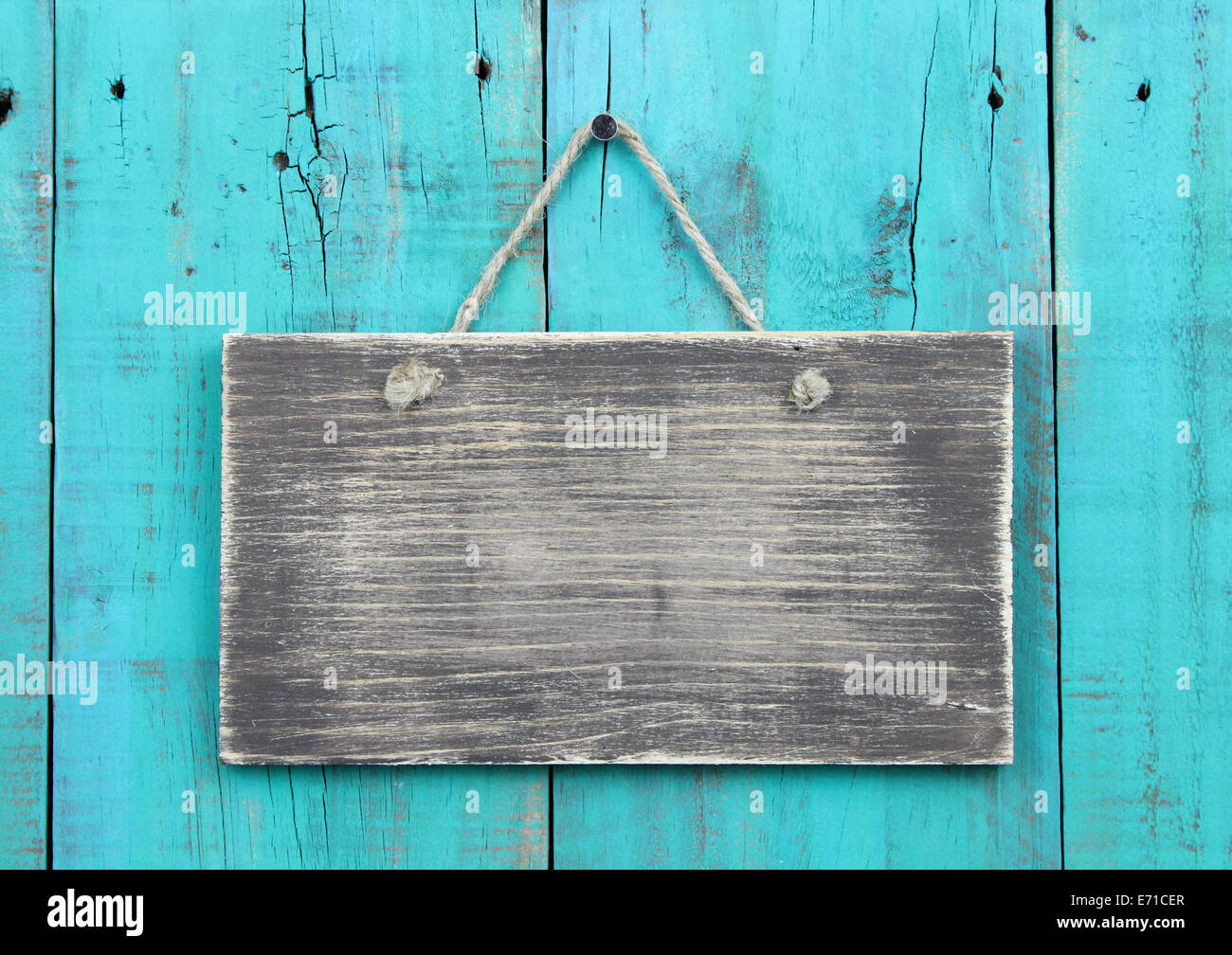 Weathered blank sign hanging on antique teal blue rustic wooden ...