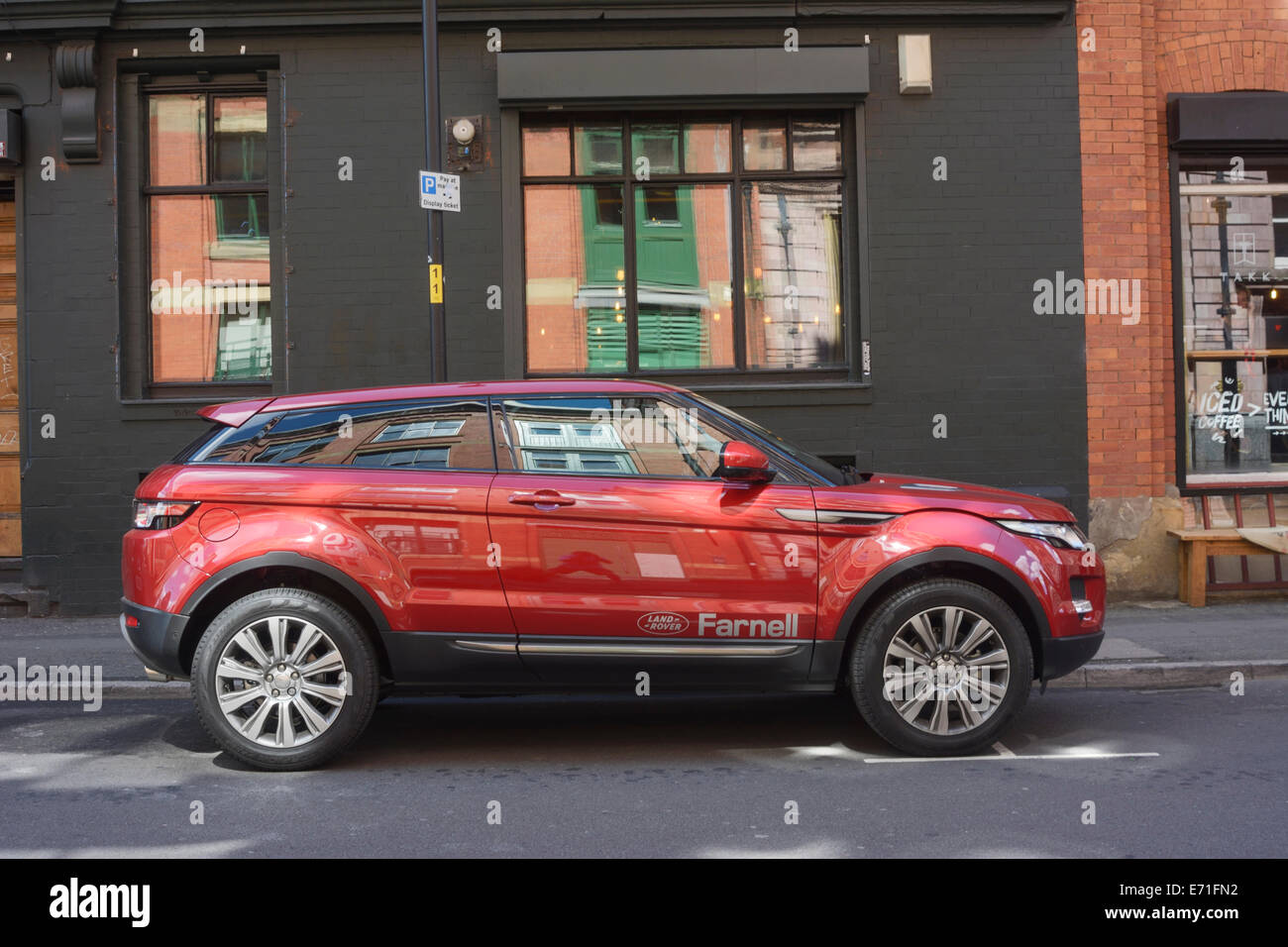 range rover evoque parked in the city streets of central manchester stock photo royalty free. Black Bedroom Furniture Sets. Home Design Ideas