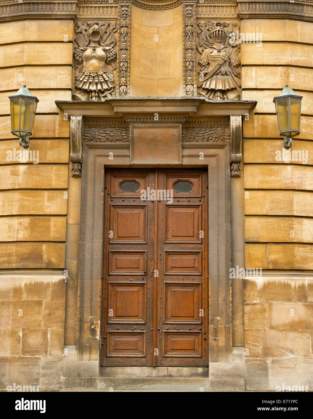 Ornate double front door with carved stonework facade Stock Photo ...