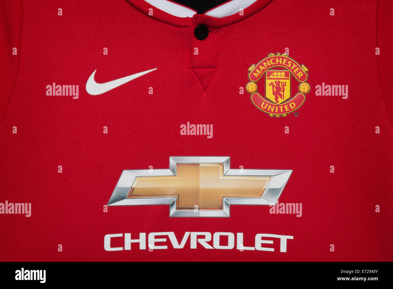 Close up of the manchester united football club home kit for Manchester united shirt sponsor