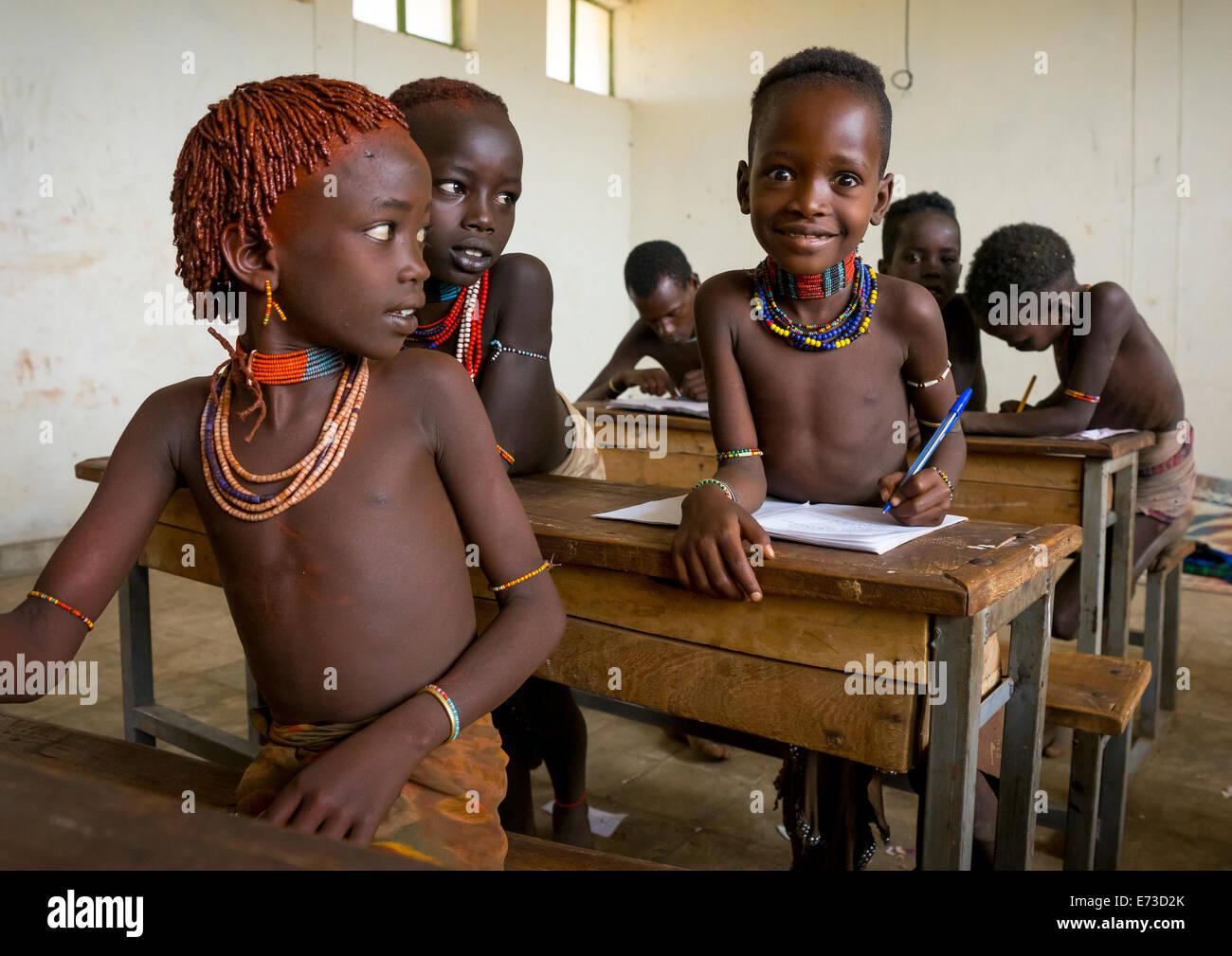 tribe kids ... Hamer Tribe Kids In A School, Turmi, Omo Valley, Ethiopia - Stock Photo